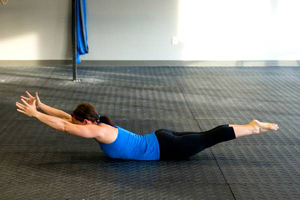 Superman back extension exercise for weightloss